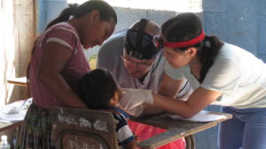 Dentists from St Francis Medical Mission team attend to village boy