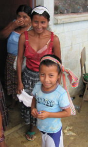 Village mother and son wait to receive medical attention from mission team